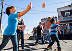 Reyna Brendlin, 10, of Sacramento, throws Spam in the Spam throwing contest at the Isleton Spam Festival at Peter's Steakhouse in Isleton, California on Sunday, February 16th, 2014.  Photo/Victoria Sheridan