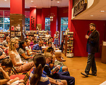 "July 26, 2017. Raleigh, North Carolina.<br /> <br />  Alan Gratz took questions after he read from his new book ""Refugee"".<br /> <br /> Author Alan Gratz spoke about and signed his new book ""Refugee"" at Quail Ridge Books. The young adult fiction novel contrasts the stories of three refugees from different time periods, a Jewish boy in 1930's Germany , a Cuban girl in 1994 and a Syrian boy in 2015."