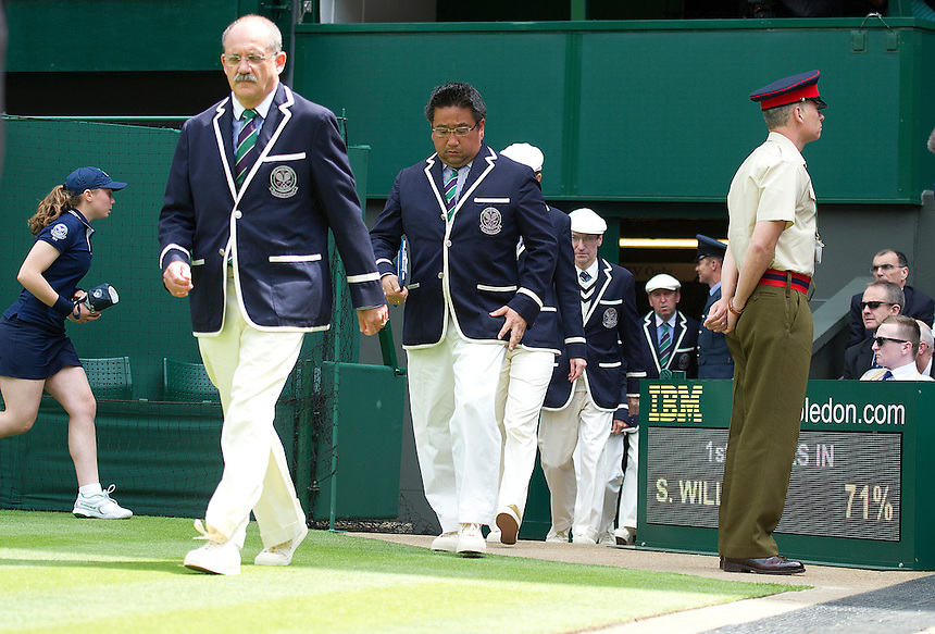 Replacement officials make their entrance during a changeover <br /> <br />  (Photo by Stephen White/CameraSport) <br /> <br /> Tennis - Wimbledon Lawn Tennis Championships - Day 2 Tuesday 25th June 2013 -  All England Lawn Tennis and Croquet Club - Wimbledon - London - England<br /> <br /> &copy; CameraSport - 43 Linden Ave. Countesthorpe. Leicester. England. LE8 5PG - Tel: +44 (0) 116 277 4147 - admin@camerasport.com - www.camerasport.com.