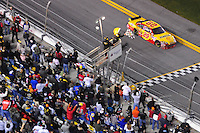 Feb 07, 2009; Daytona Beach, FL, USA; NASCAR Sprint Cup Series driver Kevin Harvick takes the checkered flag to win the Bud Shootout at Daytona International Speedway. Mandatory Credit: Mark J. Rebilas-