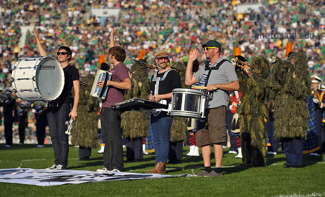 """The band Ok Go performs """"This Too Shall Pass"""" with the Notre Dame Marching band during halftime of the Pittsburgh game, Oct. 9, 2010."""