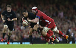 Wales lock Jake Ball tackles All Blacks scrum half Aaron Smith.<br /> Dove men Series 2014<br /> Wales v New Zealand<br /> 22.11.14<br /> &copy;Steve Pope -SPORTINGWALES