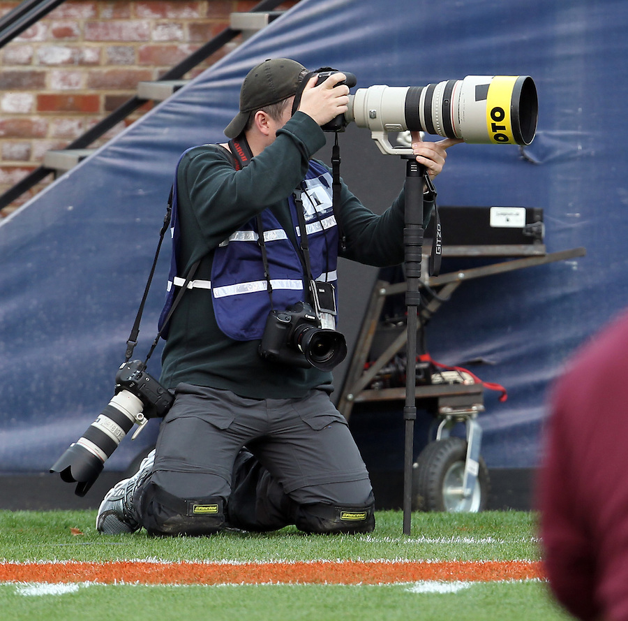 CHARLOTTESVILLE, VA- NOVEMBER 12: Photographer Jason O. Watson shoots photographs during the Virginia Tech vs. Virginia Cavaliers ACC football game on November 28, 2011 at Scott Stadium in Charlottesville, Virginia. Virginia Tech defeated Virginia 38-0. (Photo by Andrew Shurtleff/Getty Images) *** Local Caption *** Jason O. Watson