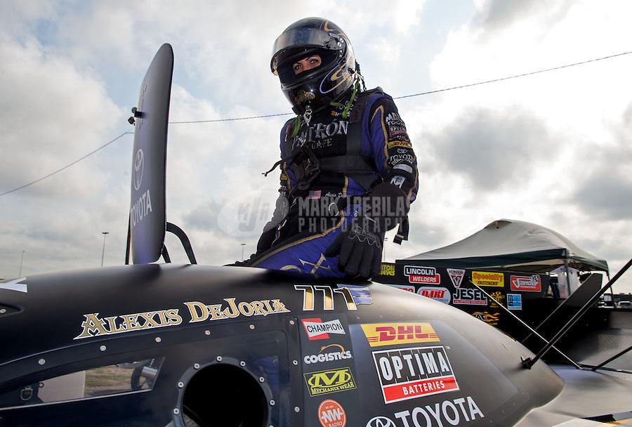 Apr 26, 2014; Baytown, TX, USA; NHRA funny car driver Alexis DeJoria during qualifying for the Spring Nationals at Royal Purple Raceway. Mandatory Credit: Mark J. Rebilas-USA TODAY Sports