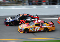 Jul. 1, 2010; Daytona Beach, FL, USA; NASCAR Sprint Cup Series driver Matt Kenseth (17) races alongside Regan Smith (78) during practice for the Coke Zero 400 at Daytona International Speedway. Mandatory Credit: Mark J. Rebilas-