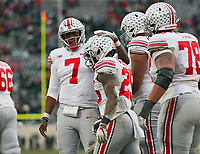 Ohio State Buckeyes quarterback Dwayne Haskins Jr. (7) congratulates running back Mike Weber Jr. (25) on scoring a touchdown during the fourth quarter of the NCAA football game against the Michigan State Spartans at Spartan Stadium in East Lansing, Mich. on Nov. 10, 2018. Ohio State won 26-6. [Adam Cairns/Dispatch]