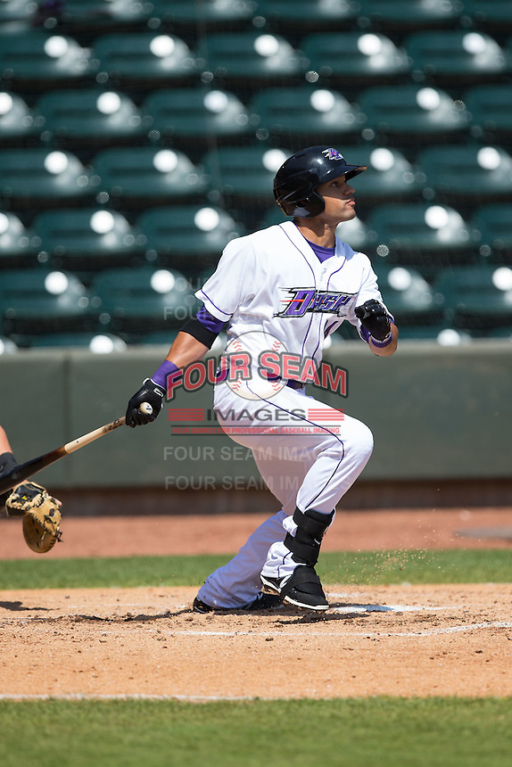 Keenyn Walker (24) of the Winston-Salem Dash follows through on his swing against the Carolina Mudcats at BB&T Ballpark on April 22, 2015 in Winston-Salem, North Carolina.  The Dash defeated the Mudcats 4-2..  (Brian Westerholt/Four Seam Images)