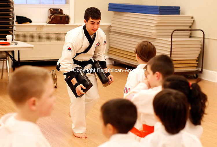 Middlebury, CT- 25 January 2013-012513CM02-  COUNTRY LIFE ONLY PLEASE--- Justin Cipriano, an instructor with Middlebury Cheezic Tang Soo Do USA Martial Arts, practices self defense drills with students Friday afternoon in Middlebury.   Christopher Massa Republican-American