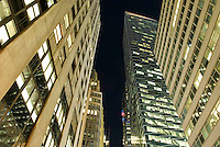 THIS IMAGE IS AVAILABLE EXCLUSIVELY FROM CORBIS.....Please search for image # 42-19896717 on www.gettyimages.com....Office Buildings on 40th Street Illuminated at Night, Midtown Manhattan, New York City, New York State, USA