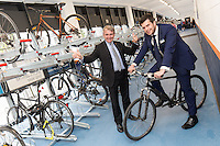 Robert Goodwill MP, Minister of State for Transport, waves off Johnny Wiseman of East Midlands Trains at the official opening of Nottingham Railway Station's new secure Cycle Hub