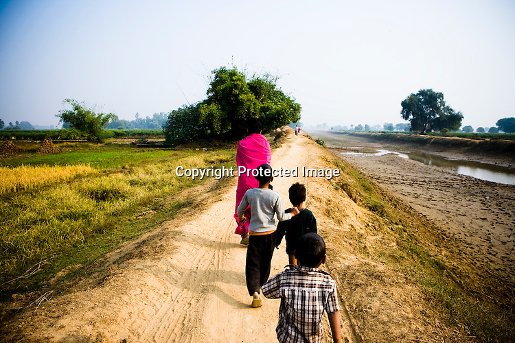 Amidst the gloom of extreme poverty, it's the colour of pink that's calling the shots in this dusty region of Bundelkhand, one of the poorest parts of one of India's northern and most populous states, Uttar Pradesh in India. A gang of vigilantes, called the Gulabi Gang (pink gang) - its 10,000 strong women members wear only pink sarees - is taking up lathi (traditional Indian cudgel) against domestic violence and corruption. ..The 47-year-old leader of the Pink Gang, Sampat Pal Devi (front) is a fiesty woman. The barely educated, impoverished mother of five, Sampat Pal Devi has emerged as a messianic figure in the region. Sampath Devi began to work as a government health worker, but she quit soon after because her job was not satisfying enough. She always wanted to work for the poor and not for herself. Taking up issues while being a government worker was difficult, so she decided to quit the job and work for the rights of people.