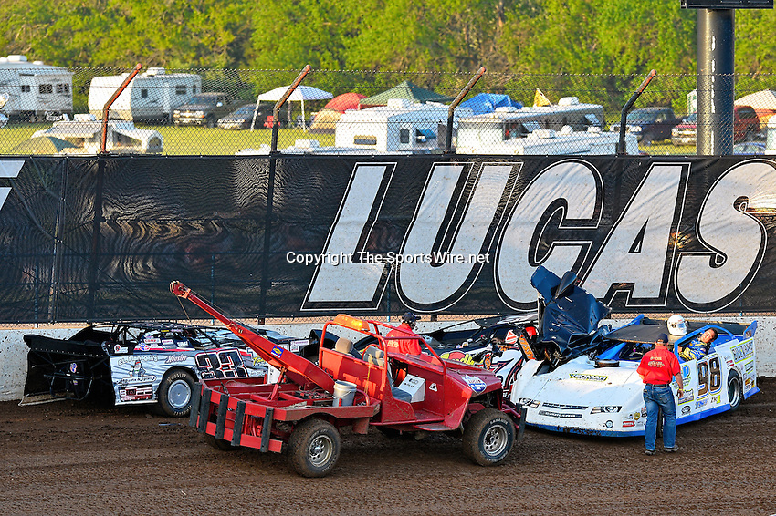 May 25, 2013; 7:40:01 PM; Wheatland, Mo., USA; The  Lucas Oil Late Model Dirt Series running the 21st Annual Lucas Oil Show-Me 100 Presented by ProtectTheHarvest.com.  Mandatory Credit: (thesportswire.net)