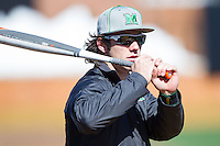 Chase Vogelbach (7) of the Marshall Thundering Herd gets loose prior to the game against the Georgetown Hoyas at Wake Forest Baseball Park on February 15, 2014 in Winston-Salem, North Carolina.  The Thundering Herd defeated the Hoyas 5-1.  (Brian Westerholt/Four Seam Images)