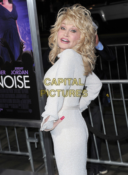 Dolly Parton.'Joyful Noise' Los Angeles premiere held at Grauman's Chinese Theatre, Hollywood, California, USA..9th January 2012.half length dress hands on hips white   side looking over shoulder .CAP/RKE/DVS.©DVS/RockinExposures/Capital Pictures.