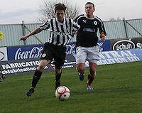 Lewis McLear is hauled back by Kyle Turnbull at the Falkirk v St Mirren  Scottish Football Association Youth Cup 4th Round match played at the Falkirk Stadium, Falkirk on 16.12.12.