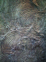 Art and education sculpture showing the swirls of a pahoehoe lava flow at Bernice Pauahi Bishop Museum's Science Center on Oahu. Lava is used for construction of roads, walls and other structures.