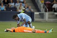 Kei Kamara (23) forward Sporting KC checks on an injured Matt Reis..Sporting Kansas City and New England Revolution played to a 0-0 tie at LIVESTRONG Sporting Park, Kansas City, KS.