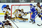 SIOUX FALLS, SD - MARCH 24: Goalie Hunter Shepard #32 from Minnesota Duluth watches the puck as Jordan Himley #10 from Air Force tries to deflect it during their game at the 2018 West Region Men's NCAA DI Hockey Tournament at the Denny Sanford Premier Center in Sioux Falls, SD. (Photo by Dave Eggen/Inertia)