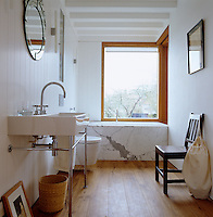 There are expansive views of the garden from the large picture window in the bathroom