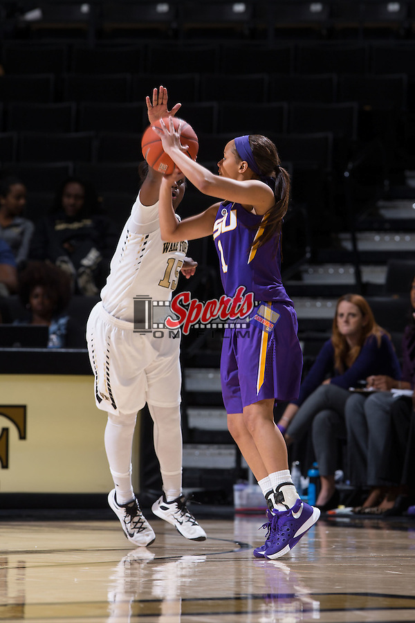 Jenna Deemer (1) of the LSU Tigers shoots over Kortni Simmons (15) of the Wake Forest Demon Deacons during second half action at the LJVM Coliseum on November 13, 2015 in Winston-Salem, North Carolina.  The Demon Deacons defeated the Tigers 60-57.  (Brian Westerholt/Sports On Film)