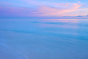 The soft pastels of sunset from a beach on Midway Atoll