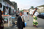 KINSHASA, DEMOCRATIC REPUBLIC OF CONGO APRIL 23: An unidentified boy dressed up to attend Sikatenda church on April 23, 2006 in central Kinshasa, Congo, DRC. The church is one of the most popular in Kinshasa and thousands off people attend it every Sunday. Many have to sit outside as the church fills up quickly. Kinshasa, a city of about eight million people is battling with bad infrastructure and no public transport. Congo, DRC is in ruins after forty years of mismanagement by the corrupt dictator and former president Mobuto Sese Seko. He fled the country in 1997 and a civil war started. The country is planning to hold general elections by July 2006, the first democratic elections in forty years.(Photo by Per-Anders Pettersson)