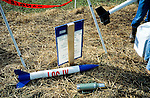 Rockets laid  out on the ground  at an amateur rocket festival..Manchester, Tennessee.