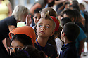 A first grader sports a spiked hairdo as he listens to instructions from his teacher on the first day of school at Jefferson Elementary School in Carlsbad, California.   photo for North County Times
