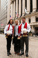U.S. Women's National Team midfielder Carli Lloyd, U.S. Soccer President Sunil Gulati, and former U.S. Men's National Team star Jeff Agoos pose for a photo prior to ringing the closing bell of the NYSE during the centennial celebration of U. S. Soccer at the New York Stock Exchange in New York, NY, on April 02, 2013.