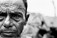 Blind in one eye after being beaten in the head during forced labor, this Rohingya man fled from Burma in the mid 1990's and is one of an estimated 250,000 stateless Rohingya living in the southern part of neighboring Bangladesh.