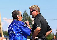 Aug. 3, 2014; Kent, WA, USA; NHRA funny car driver Tommy Johnson Jr (right) talks with Terry Chandler during the Northwest Nationals at Pacific Raceways. Mandatory Credit: Mark J. Rebilas-