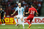 Emanuel Mammana of Argentina (L) fights for the ball with Hafiz Sujad of Singapore (R) during the International Test match between Argentina and Singapore at National Stadium on June 13, 2017 in Singapore. Photo by Marcio Rodrigo Machado / Power Sport Images