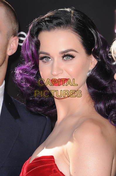 """Katy Perry.""""Katy Perry: Part Of Me"""" Los Angeles Premiere held at Grauman's Chinese Theatre, Hollywood, California, USA..June 26th, 2012.headshot portrait red strapless velvet dyed purple hair lipstick                                                    .CAP/RKE/DVS.©DVS/RockinExposures/Capital Pictures."""