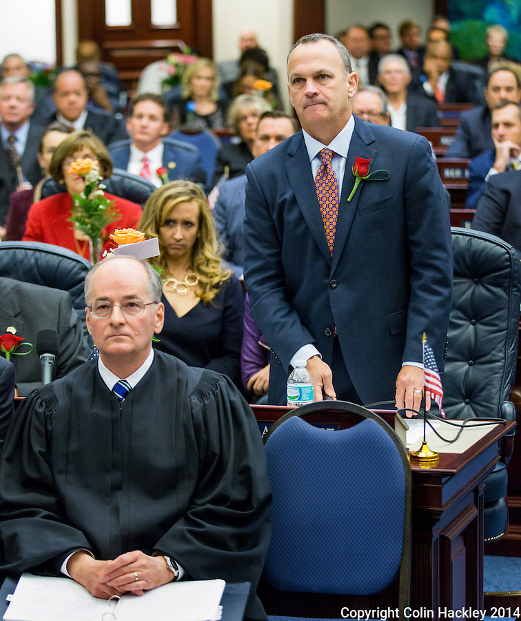 TALLAHASSEE, FLA. 11/18/14-ORGSESS111814CH-Rep. Richard Corcoran, R-Land O'Lakes, standing, moves that the House not accept the results of District 64, pending a hearing by the Florida Supreme Court as Supreme Court Justice Charles Canady, seated left, listens during Organizational Session, Nov. 18, 2014 at the Capitol in Tallahassee. Rep. James Grant, R-Tampa, won the seat but the results have been called into question by write-in candidate and a special election may be called by Gov. Rick Scott. <br /> <br /> COLIN HACKLEY PHOTO