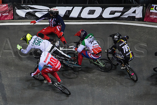 09.04.2016. National Cycling Centre, Manchester, England. UCI BMX Supercross World Cup day 1. Justin Posey and Mathew Cameron fall, as Evgeny Komarov, Romain Riccardi and Miguel Alejandro Calixto Lopez take avoiding action.
