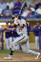 Auburn Tigers second baseman Jordan Ebert #23 follows through on his swing against the LSU Tigers in the NCAA baseball game on March 22nd, 2013 at Alex Box Stadium in Baton Rouge, Louisiana. LSU defeated Auburn 9-4. (Andrew Woolley/Four Seam Images).