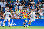 Rodrigo Moreno (c) of Valencia CF fights for the ball with Mateo Kovacic (r) of Real Madrid during their La Liga 2017-18 match between Real Madrid and Valencia CF at the Estadio Santiago Bernabeu on 27 August 2017 in Madrid, Spain. Photo by Diego Gonzalez / Power Sport Images