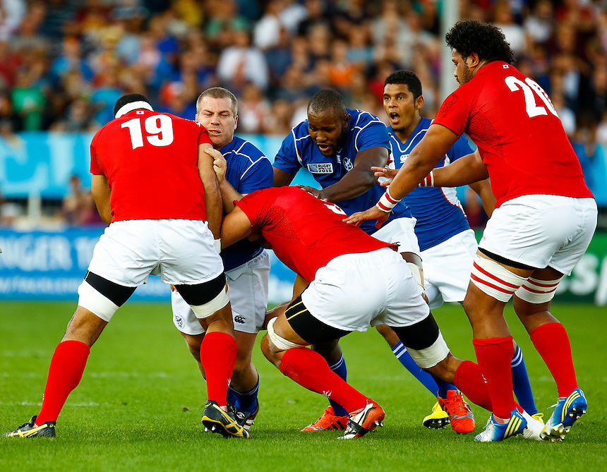 /Na16/ under pressure from Tonga's Lua Lokotui<br /> <br /> Photographer Simon King/CameraSport<br /> <br /> Rugby Union - 2015 Rugby World Cup Pool C - Namibia v Tonga - Tuesday 29th September 2015 - Sandy Park - Exeter<br /> <br /> &copy; CameraSport - 43 Linden Ave. Countesthorpe. Leicester. England. LE8 5PG - Tel: +44 (0) 116 277 4147 - admin@camerasport.com - www.camerasport.com