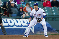 Round Rock Express third baseman Mike Olt #20 on defense against the Omaha Storm Chasers in the Pacific Coast League baseball game on April 4, 2013 at the Dell Diamond in Round Rock, Texas. Round Rock defeated Omaha in their season opener 3-1. (Andrew Woolley/Four Seam Images).