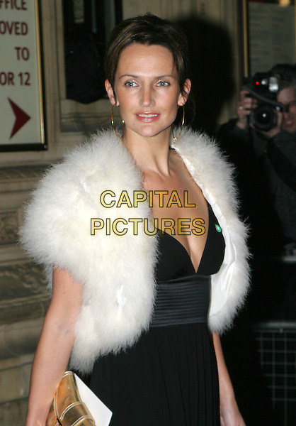 SAFFRON ALDRIDGE.Cirque Du Soleil charity performance at the Royal Albert Hall and aftershow dinner at the V&A Museum.5 February 2004.half length, half-length, fur wrap collar, cleavage.www.capitalpictures.com.sales@capitalpictures.com.© Capital Pictures.