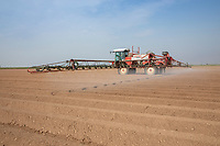 Applying residual herbicide to potato ridges - Lincolnshire, April