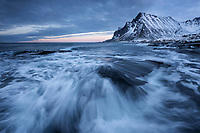 Waves crash over rocky shoreline at Viknen, Flakstadøy, Lofoten Islands, Norway