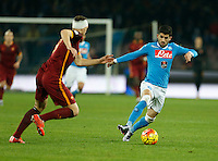Napoli's Elseid Hysaj controls the ball during the  italian serie a soccer match,between SSC Napoli and AS Roma       at  the San  Paolo   stadium in Naples  Italy ,December 13, 2015