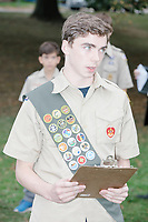 Robert Mountain, age 17, an Eagle Scout candidate, speaks to those assembled before a flag retirement ceremony he organized in Belmont, Massachusetts, USA, on Sat. Oct. 14, 2017. Flags were burned as part of the ceremony in order to give a dignified end to flags no longer fit to serve as a symbol for the United States of America. The ceremony was organized by Eagle Scout candidate Robert Mountain, 17, of Belmont Boy Scout Troop 66 as his Eagle Scout project.  The ceremony was held in park area surrounding Clay Pit Pond near Belmont High School.