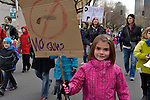 "This girl was among hundreds of Seattle residents who marched from Westlake Center Park to the Seattle Center on January 13, 2013, calling for stricter regulations of firearms. Sponsored by a network of churches and other groups called ""Stand-up Washington,"" the demonstrators called for a state ban on semi-automatic weapons as well as stricter gun laws."