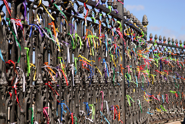 Brazil, Bahia, Salvador: Colorful miracle ribbons decorating the fencing of the church Igreja do Bonfim (1754) on Salvador's peninsula Itapagipe. --- Info: The fita, or miracle ribbons, of Senhor do Bonfim comes in many colors and is nomally tied around a persons wrist. Its primary function is to petition for future miracles rather than to remind anyone of previous such interventions. The fita is also worn to promote Brazilian pride or as a souvenir by tourists. --- No signed releases available.