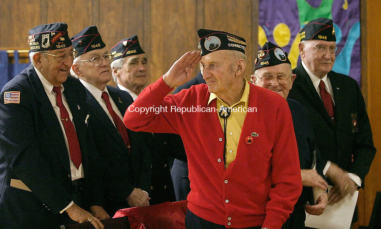 SEYMOUR, CT- 27 FEBRUARY 2005-022705J02-Iwo Jima survivor Bill Wood of Terryville, (in red) salutes to the crowd as he and other Connecticut Iwo Jima survivors are honored during a ceremony Sunday at the Marine Corp Hall at the FourSquare Gospel Church in Seymour. The program marked the 60th anniversary of the battle of Iwo Jima.  --- Jim Shannon Photo--Bill Wood; Terryville; Connecticut; Iwo Jima; Marine Corp Hall; FourSquare Gospel Church; Seymour are CQ