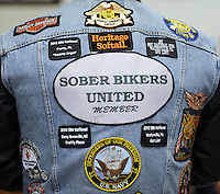 BENSALEM, PA - OCTOBER 5: A Sober Bikers United patch rests on the back of Jim Miller of Levittown, Pennsylvania at the Libertae 10th Annual Biker's and Babes Ride October 5, 2014 in Bensalem, Pennsylvania.  Libertae, a women's substance abuse treatment center, hosted the event, which runs through Bucks County before ending at Core Creek Park. (Photo by William Thomas Cain/Cain Images)