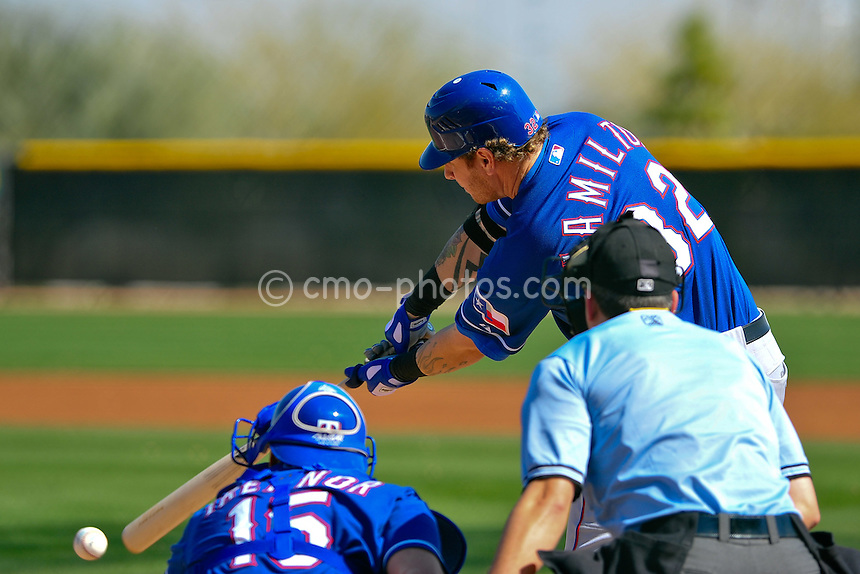Feb 24, 2011; Surprise, AZ, USA; Texas Rangers left fielder Josh Hamilton hits a ground ball during an intra-squad game played by the Rangers at the Surprise Recreation Campus.