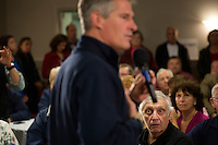 Paul Cardello (right) listens as Senator Scott Brown (R-MA) speaks to a crowd gathered the VFW Post 88 for a campaign stop in North Billerica, Massachusetts, USA, on Thurs., Nov. 2, 2012. Senator Scott Brown is seeking re-election to the Senate.  His opponent is Elizabeth Warren, a democrat.